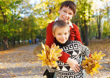 Mother and her son in a autumn park Stock Images