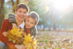Mother and her son in a autumn park Stock Image