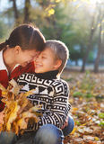 Mother and her son in a autumn park Stock Photography