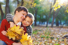 Mother and her son in a autumn park Stock Photo