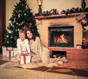Mother with her son in Christmas decorated house Stock Photography