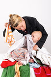 Mother and her son doing laundry Stock Photography