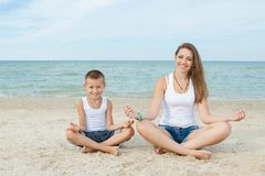 Mother and her son doing yoga Stock Images