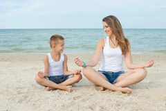 Mother and her son doing yoga Royalty Free Stock Photography