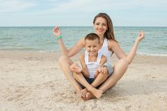 Mother and her son doing yoga Royalty Free Stock Images