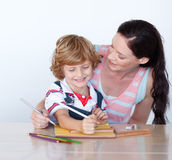 Mother and her son drawing Royalty Free Stock Images