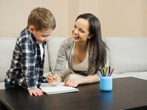 Mother with her son drawing Stock Images