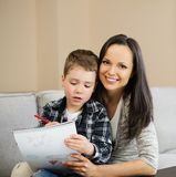 Mother with her son drawing Royalty Free Stock Photos