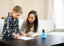 Mother with her son drawing Stock Photography