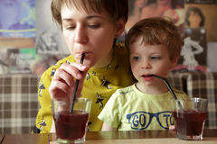 Mother with her son drinking juice. In cafe Stock Image