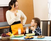 Mother and her son eating breakfast Royalty Free Stock Image