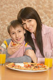 Mother with her son eating pizza Stock Photo
