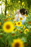 Mother with her son in the field with sunflowers Royalty Free Stock Image