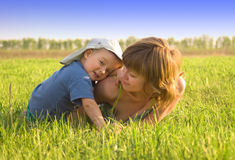 Mother and her son on the grass Royalty Free Stock Photography