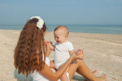 Mother and her son having fun on the beach Stock Photography
