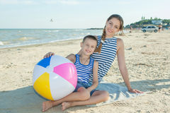 Mother and her son having fun on the beach Royalty Free Stock Images