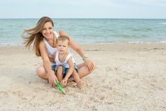 Mother and her son having fun on the beach Royalty Free Stock Photo