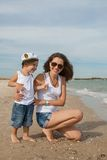 Mother and her son having fun on the beach Royalty Free Stock Image