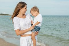 Mother and her son having fun on the beach Royalty Free Stock Photography