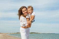 Mother and her son having fun on the beach Royalty Free Stock Photos
