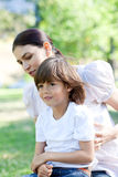 Mother and her son having fun in a park. Attentive Mother and her son having fun in a park royalty free stock image