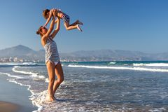 A Mother and her son is having fun at seashore of Mediterranean. Sea stock images