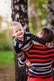 Mother with her son in her arms hugging communicate, play, Stock Images