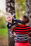 Mother with her son in her arms hugging communicate, play, Stock Photos