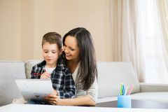 Mother with her son in home interior Stock Photo