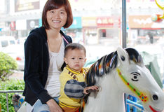 Mother and her son horse riding Stock Images