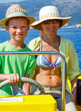 Mother with her son in a motorboat. Royalty Free Stock Photography