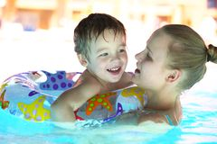 Mother and her son in the outdoor swimming pool Royalty Free Stock Photos