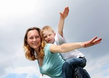Mother with her son outdoors Stock Photo