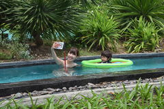 Mother and her son are palying at pool side Royalty Free Stock Photography
