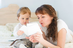 Mother and her son with paper cards Royalty Free Stock Photo