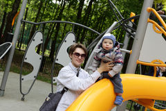 Mother with her son at playground Royalty Free Stock Image