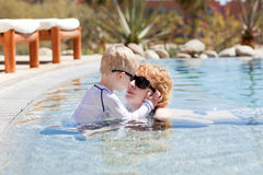 Mother and her son in the pool Stock Photo