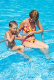 Mother with her son in the pool. Stock Photo