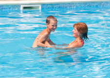 Mother with her son in the pool. royalty free stock image