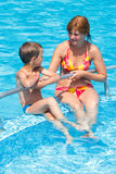 Mother with her son in the pool. Stock Image