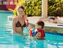 Mother with her son in the pool Stock Images