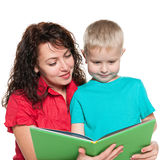 Mother and her son read book Stock Photography