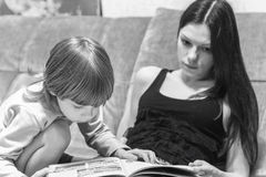 Mother and her son read book Stock Photo