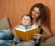 Mother with her son reading book Royalty Free Stock Photo