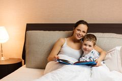 Mother and her son reading book Stock Image
