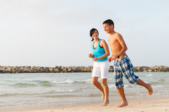 Mother with her son are running on the beach Royalty Free Stock Image