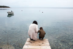 Mother and her son by the sea Stock Images