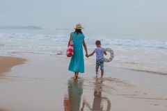Mother with her son of the seashore on a cloudy day.  Royalty Free Stock Images