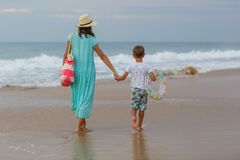 Mother with her son of the seashore on a cloudy day.  Royalty Free Stock Image