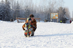 Mother with her son on a snow Stock Image